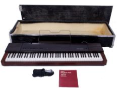 Yamaha PF15 Electronic Piano with wooden flight case.