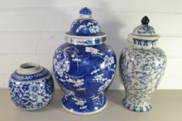 LARGE CHINESE PORCELAIN JAR AND COVER WITH PRUNUS DESIGN TOGETHER WITH A FURTHER JAR AND COVER