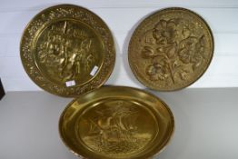 THREE BRASS TRAYS WITH VARIOUS DECORATION IN RELIEF