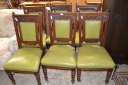 SET OF LEATHER UPHOLSTERED OAK DINING CHAIRS WITH CARVED DETAIL, EACH WIDTH APPROX 48CM