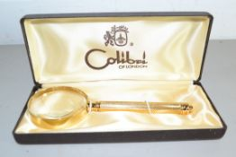 GOLD COLOURED MAGNIFYING GLASS BY COLIBRI, IN ORIGINAL BOX