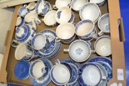 TRAY CONTAINING BLUE AND WHITE WARES, MAINLY CUPS AND SAUCERS AND BLUE AND WHITE TEA POT