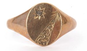 9ct gold and diamond gents signet ring, the oval panel highlighted with a small diamond in a star