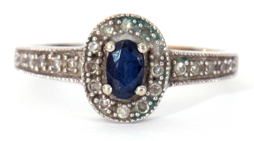 Modern 375 stamped synthetic sapphire and diamond ring, the oval shaped centre stone raised above - Image 2 of 10