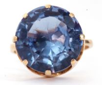 Modern 585 stamped single blue stone dress ring, round faceted shape, 12mm diam, coronet set in a