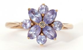 Modern 9ct pale purple stone and small diamond cluster ring, stamped 9K, size O