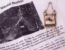 Russian Nikolai Nuzhin designer pendant, the centre with a square coloured ceramic plaque, bezel set