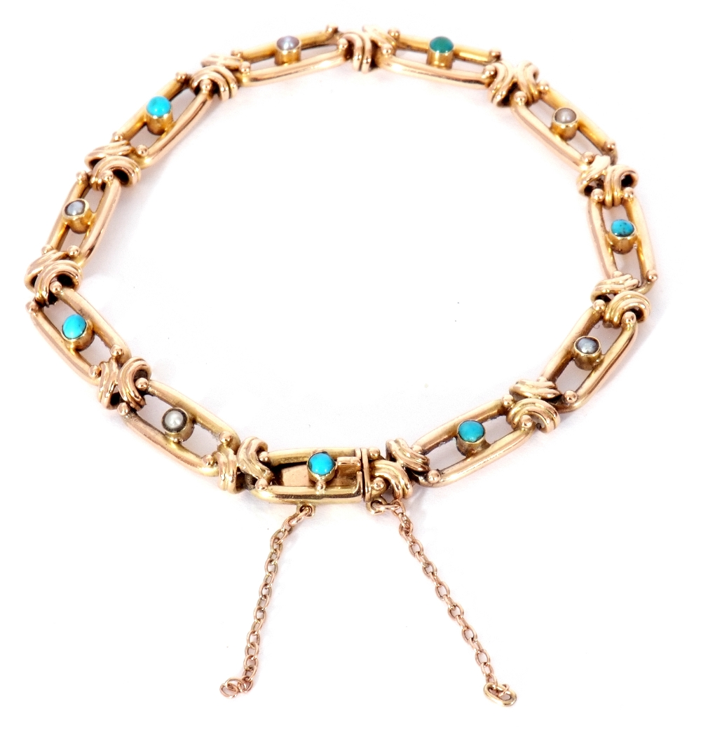 Vintage 15ct stamped bracelet, the oval open work links alternate set centring a turquoise and a