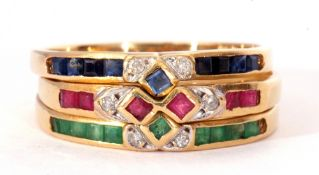 Three modern stacking rings, sapphire, ruby and emerald set, each highlighted with small diamonds,