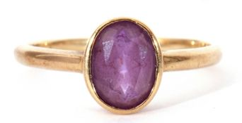 9ct gold amethyst ring, the oval faceted amethyst bezel set in a plain polished mount, size M