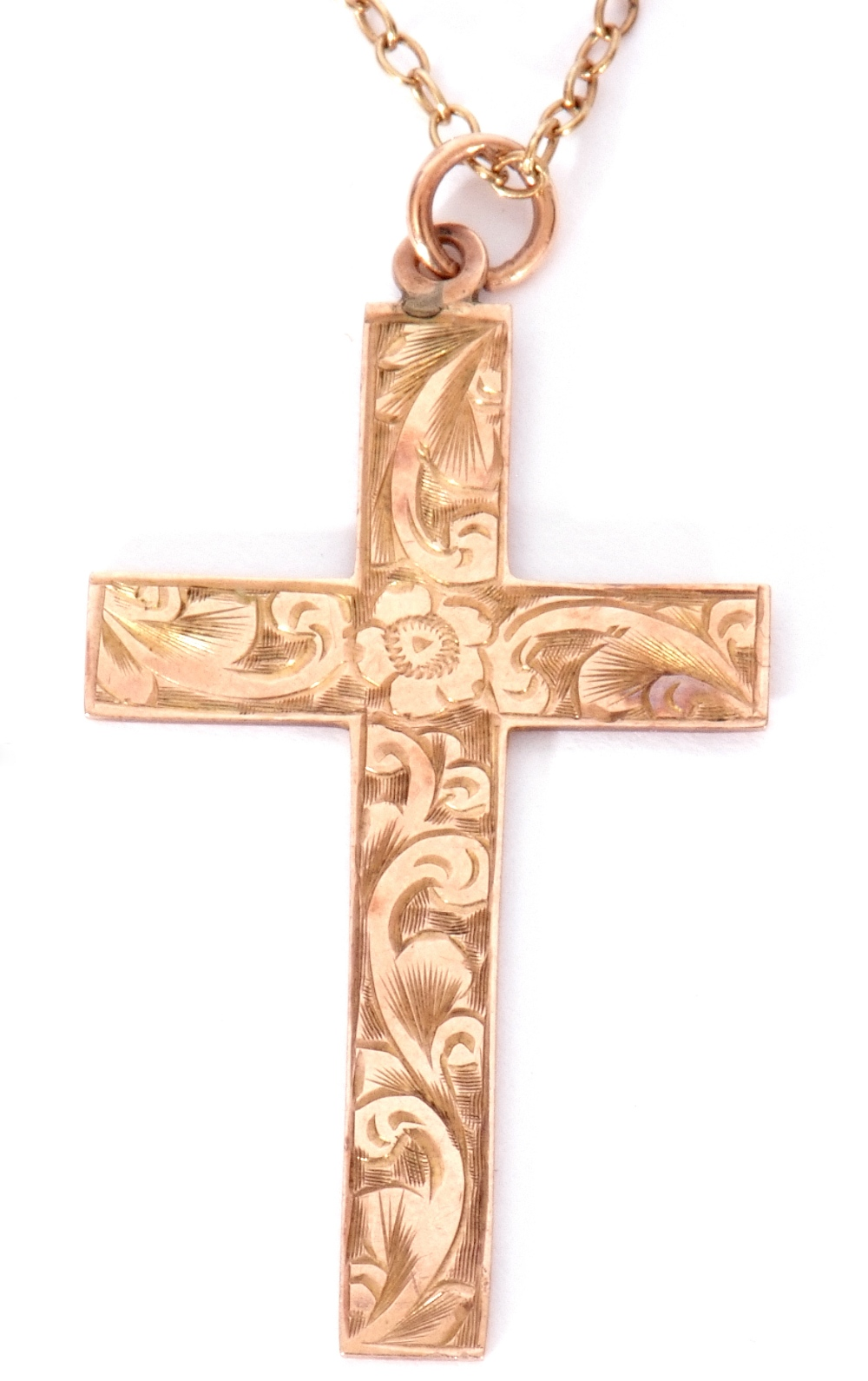 9ct stamped cross pendant, chased and engraved scroll decorated front, 35 x 22mm