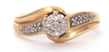 Modern 9K stamped diamond cross-over ring centring a small diamond, 0.03ct approx, raised above