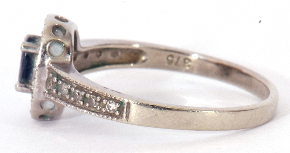 Modern 375 stamped synthetic sapphire and diamond ring, the oval shaped centre stone raised above - Image 4 of 10