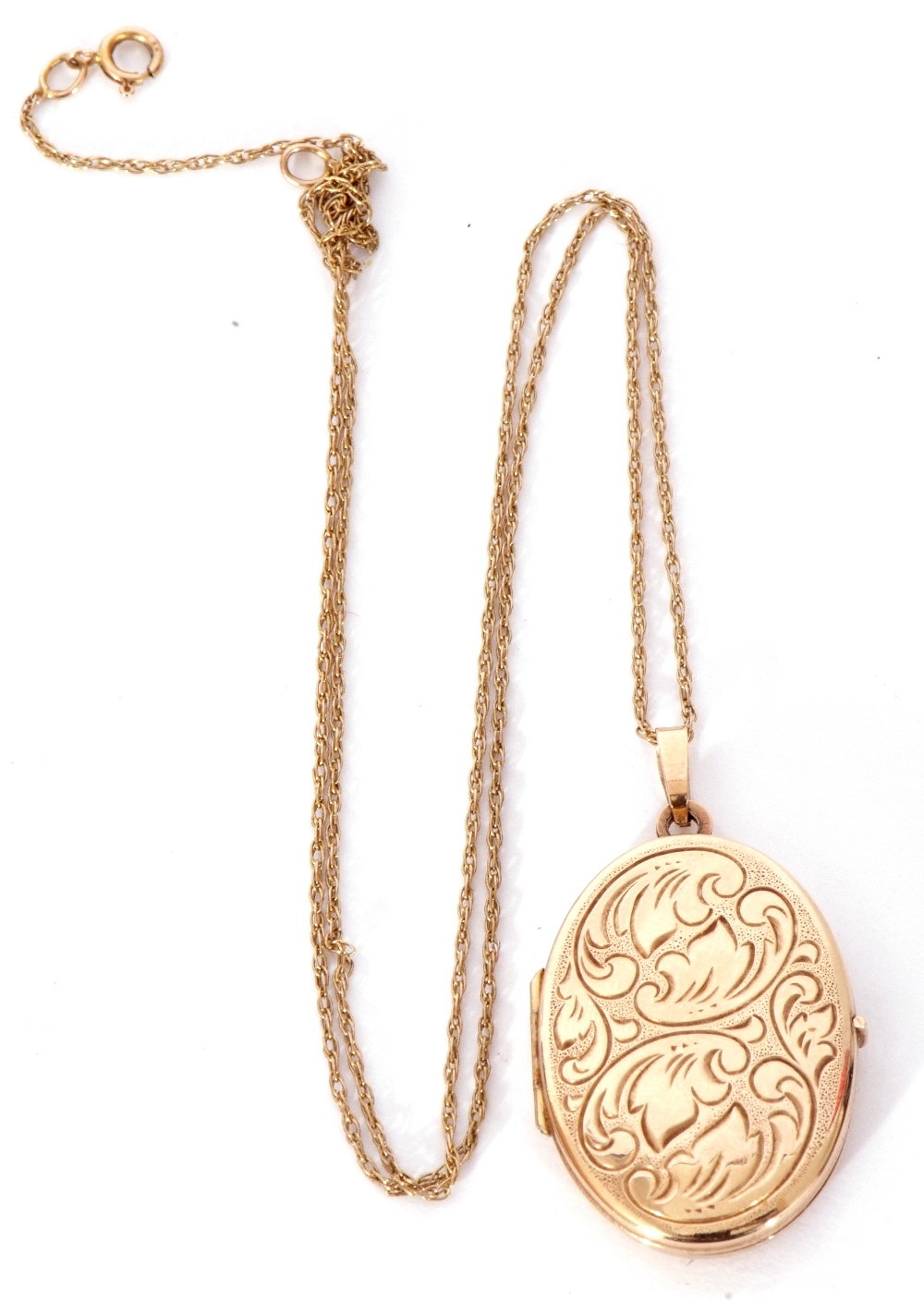 Modern oval yellow metal hinged locket, the front with engraved detail, burnished verso, suspended