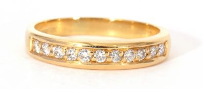 Diamond set half hoop ring featuring 11 small round brilliant cut diamonds, each individually claw