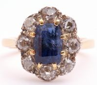Sapphire and diamond cluster ring, the centre rectangular step cut sapphire 8 x 6mm, surrounded by 8