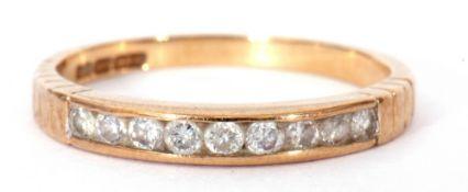 9ct gold diamond half hoop ring featuring nine round channel set small brilliant cut diamonds,