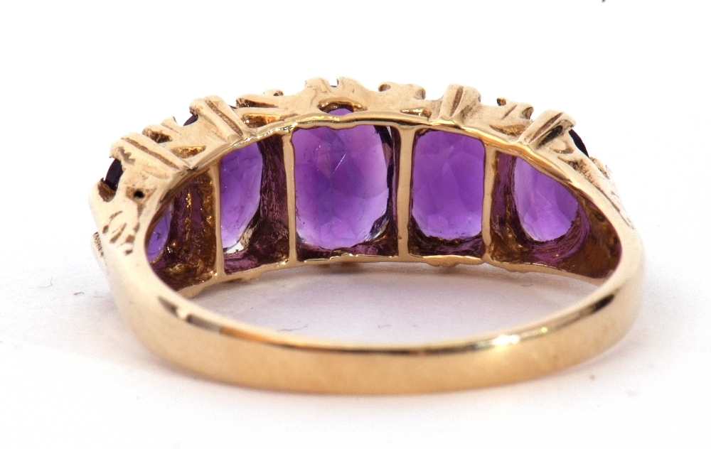 9ct gold amethyst five stone ring, featuring five graduated oval shaped amethysts, all in a carved - Image 6 of 9