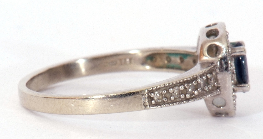 Modern 375 stamped synthetic sapphire and diamond ring, the oval shaped centre stone raised above - Image 7 of 10