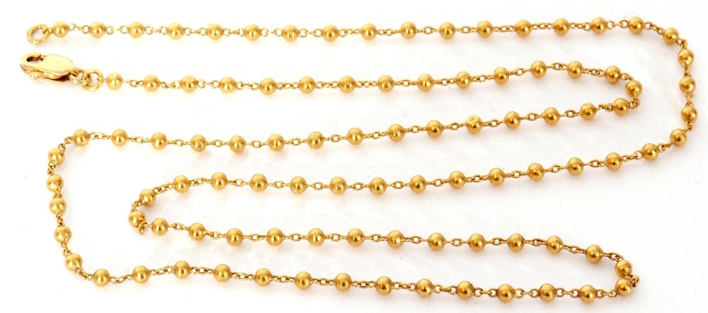 High grade yellow metal chain, oval link and bead design, 29.5cm fastened, 7.8gms (tests for 18ct
