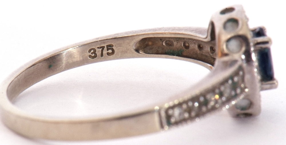 Modern 375 stamped synthetic sapphire and diamond ring, the oval shaped centre stone raised above - Image 9 of 10