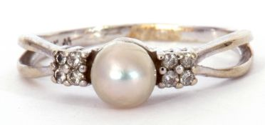 Modern 14K stamped cultured pearl and diamond ring, the cultured pearl set between small diamond