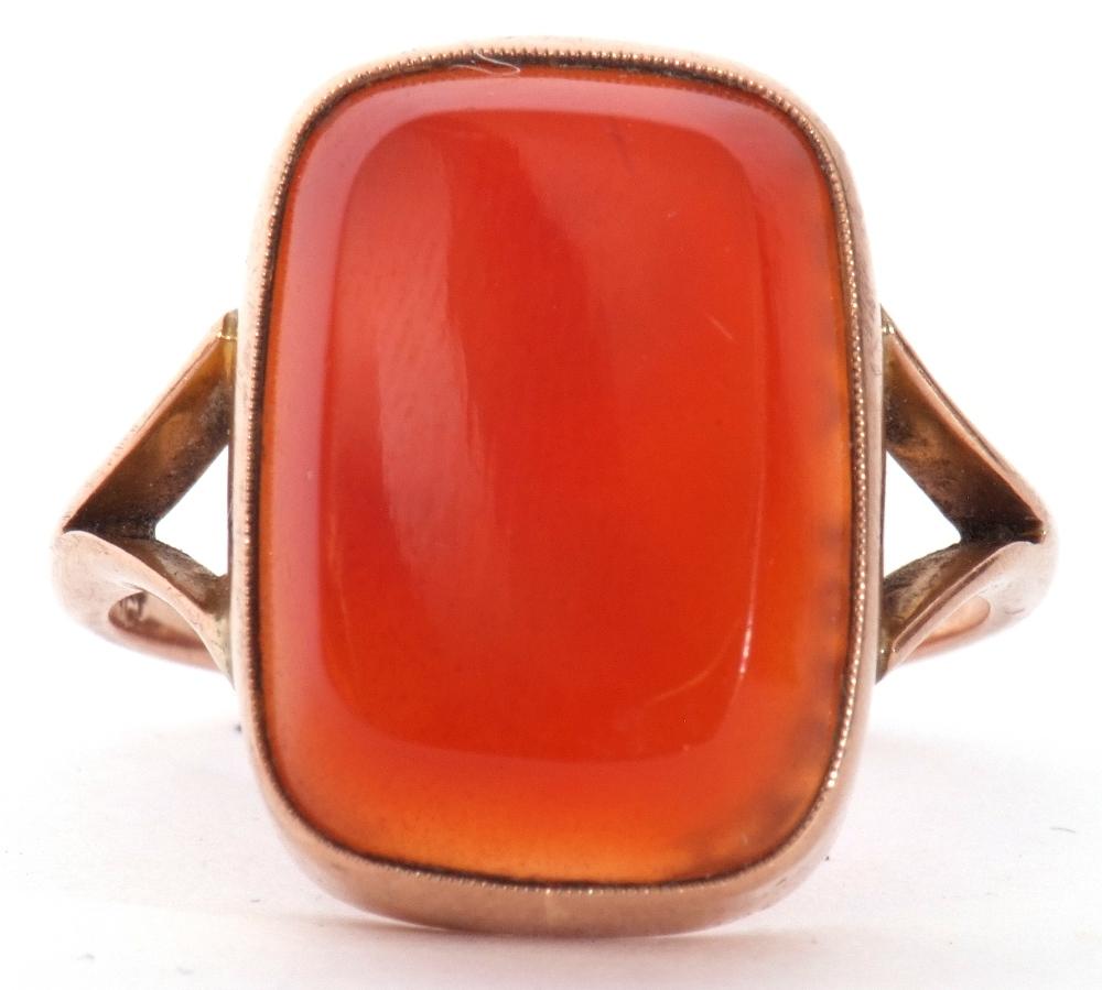 9ct stamped carnelian dress ring, the rectangular cut carnelian 18 x 12mm, bezel set and raised