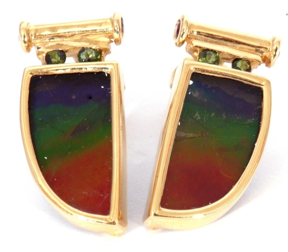 Pair of ammolite earrings, a tusk design, each with a bezel set ammolite stone in 18K mounts, 2cm