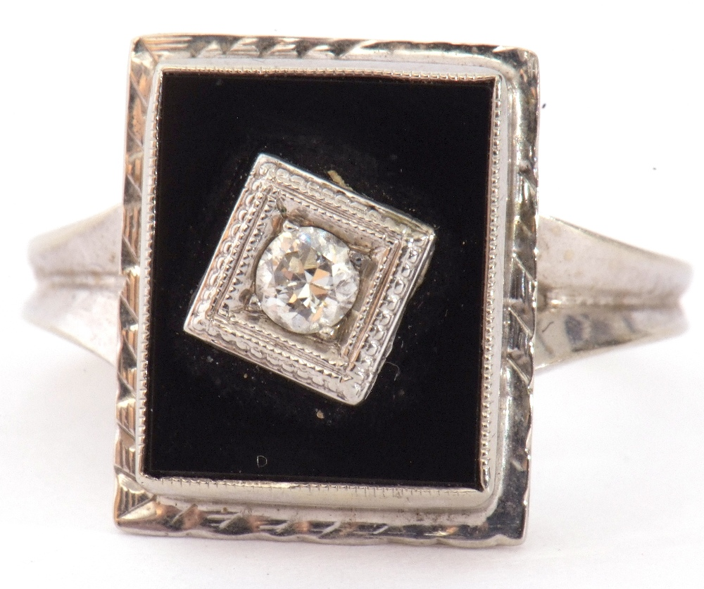 Art Deco style diamond and onyx ring, the rectangular shaped onyx panel 12 x 8mm, centrally set with