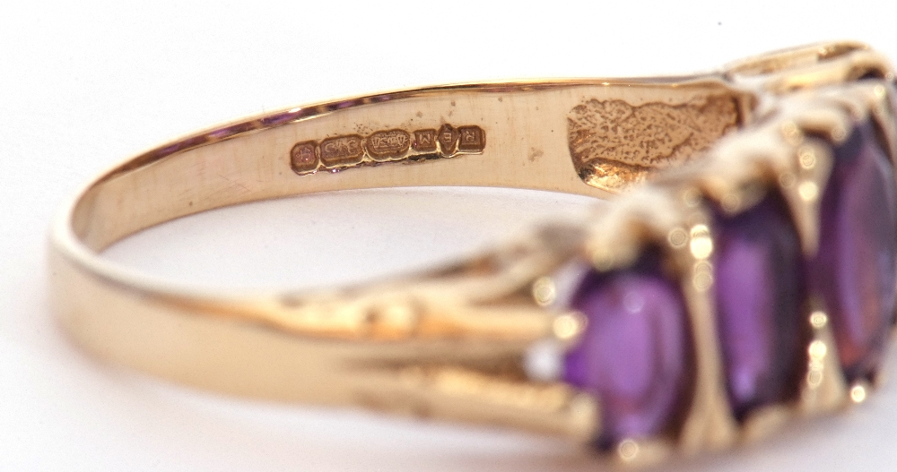 9ct gold amethyst five stone ring, featuring five graduated oval shaped amethysts, all in a carved - Image 9 of 9
