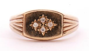 9ct gold signet ring, the barrel shaped panel highlighted with four small single cut diamonds in