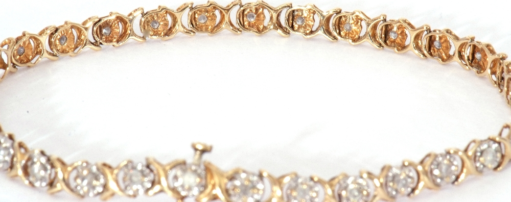Diamond set line bracelet featuring 30 small diamonds, each in an illusion setting, joined by X- - Image 3 of 6