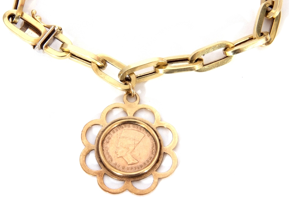 a 585 stamped hollow oval link bracelet, suspending a framed Nofretete Regina coin, stamped verso - Image 2 of 6