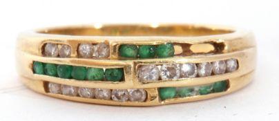 Emerald and diamond set half hoop ring, an Art Deco design of three bands of channel set diamonds