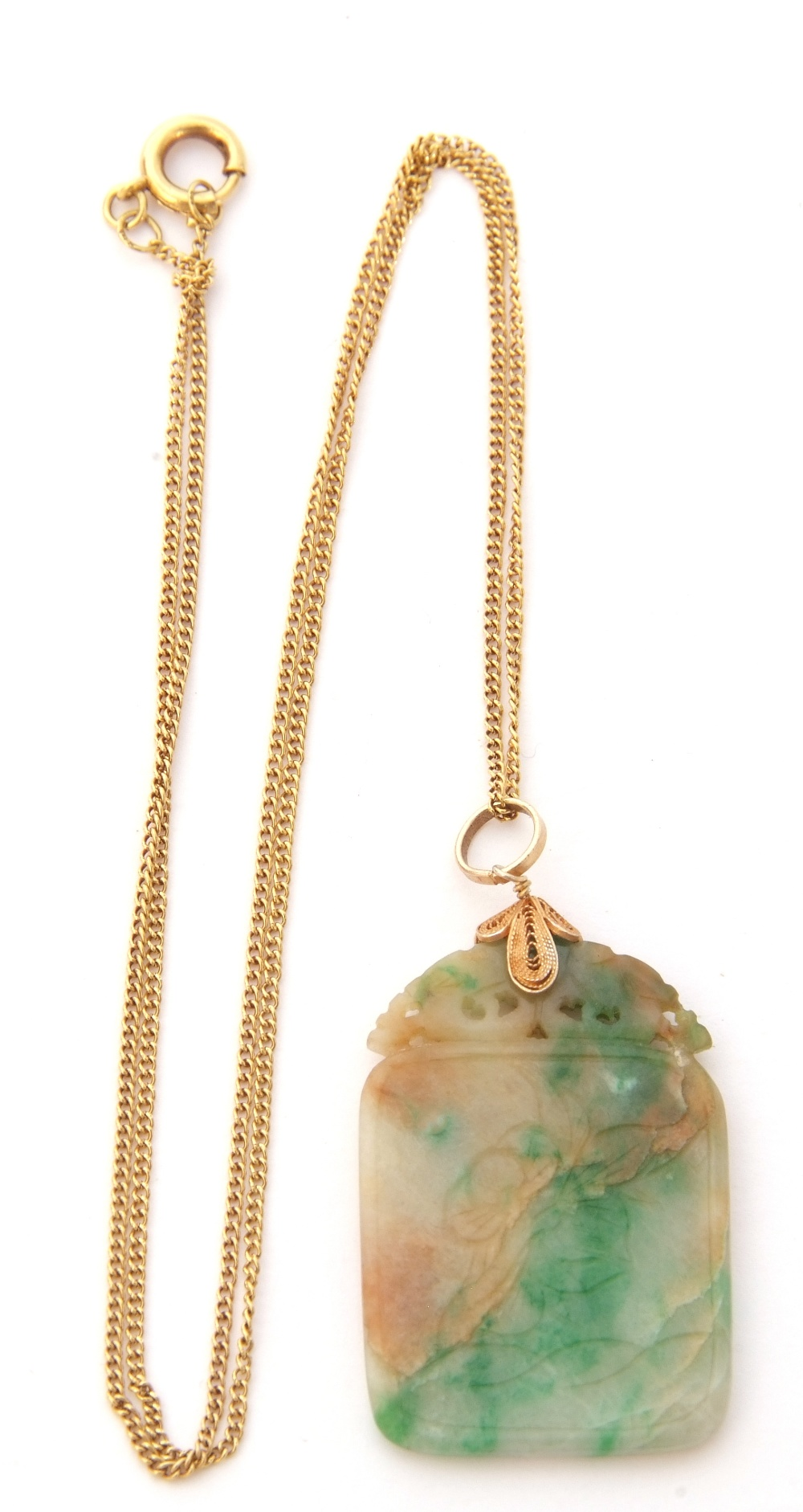 Modern jade pendant, 3 x 2cm, on a silver gilt bale, suspended from a 14K marked chain
