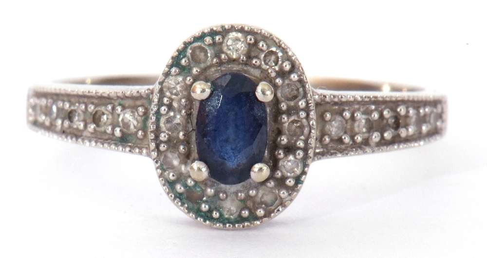 Modern 375 stamped synthetic sapphire and diamond ring, the oval shaped centre stone raised above - Image 10 of 10