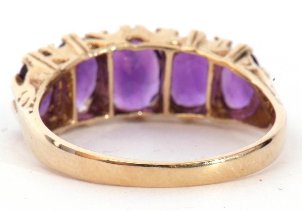9ct gold amethyst five stone ring, featuring five graduated oval shaped amethysts, all in a carved - Image 7 of 9