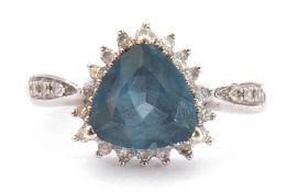 Modern 9ct white gold and apatite ring, heart shaped, within a small diamond surround and