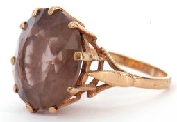 Modern 9ct gold smoky quartz dress ring, the round faceted quartz 16mm diam, multi-claw set in a