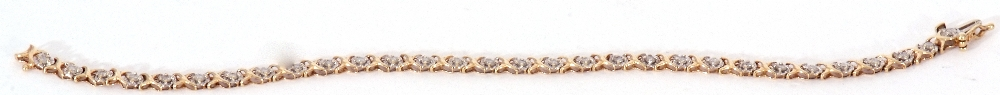 Diamond set line bracelet featuring 30 small diamonds, each in an illusion setting, joined by X- - Image 5 of 6