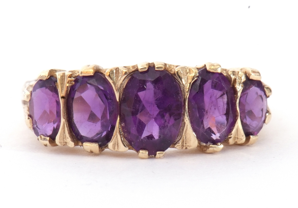 9ct gold amethyst five stone ring, featuring five graduated oval shaped amethysts, all in a carved - Image 3 of 9