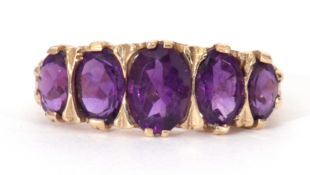 9ct gold amethyst five stone ring, featuring five graduated oval shaped amethysts, all in a carved - Image 4 of 9