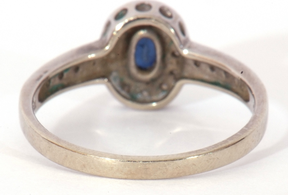 Modern 375 stamped synthetic sapphire and diamond ring, the oval shaped centre stone raised above - Image 6 of 10