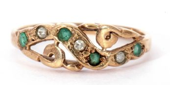 9ct gold emerald and diamond ring, the pierced carved mount alternate set with four small emeralds