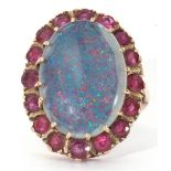 9ct gold opal doublet and ruby ring, the large cabochon opal doublet multi-claw set within a