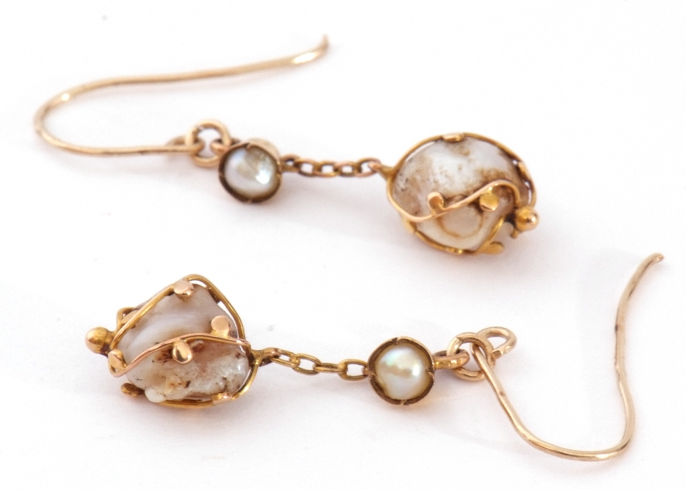 Pair of antique baroque pearl drop earrings, each with a boulder shape pearl in a beaded strap