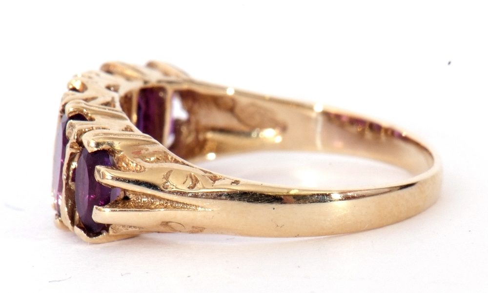 9ct gold amethyst five stone ring, featuring five graduated oval shaped amethysts, all in a carved - Image 5 of 9