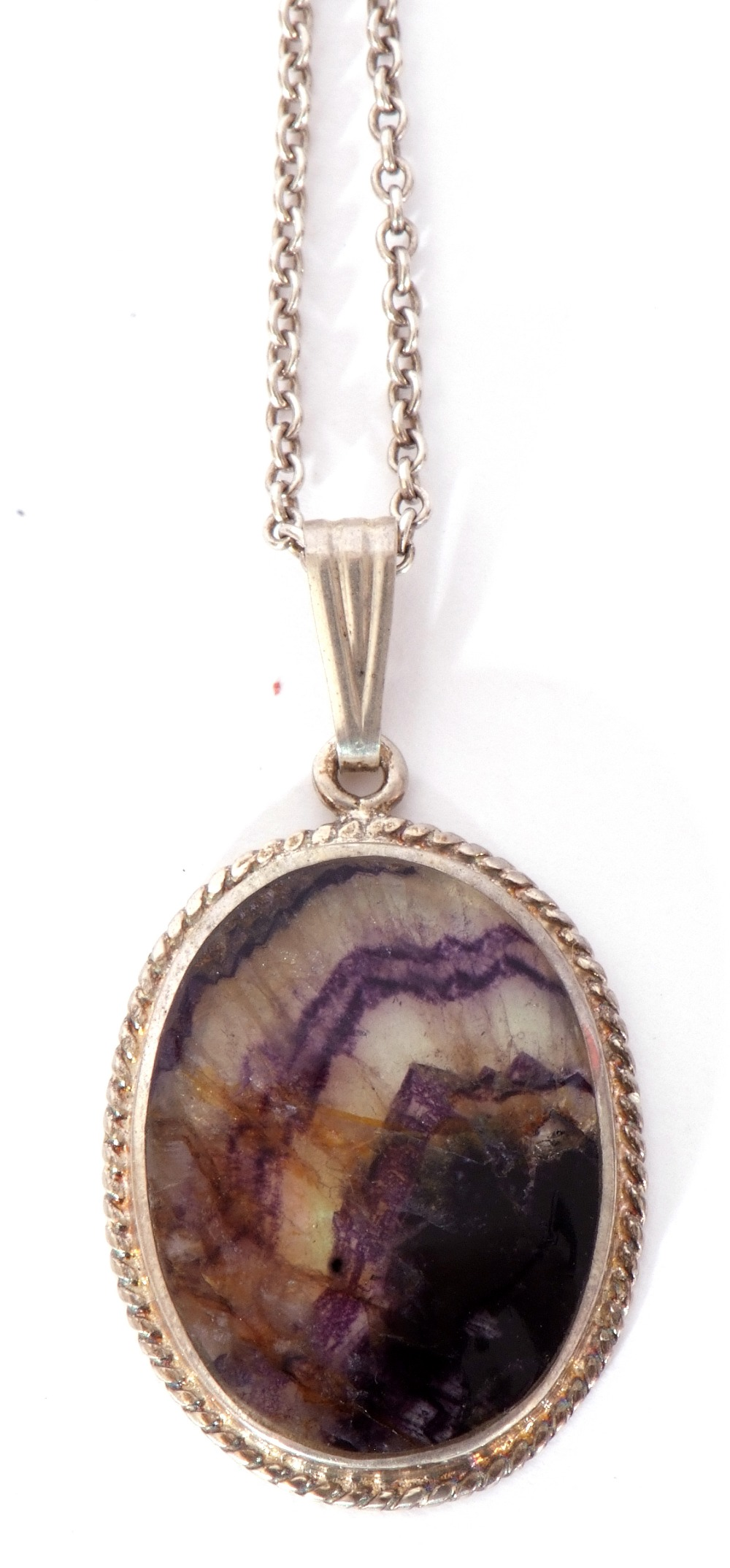 A Blue John oval pendant, 30 x 20mm, framed in a white metal mount and rope twist frame, suspended - Image 3 of 5
