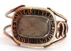Georgian gold mourning ring, the glazed panel with plaited hair beneath, framed with black and white