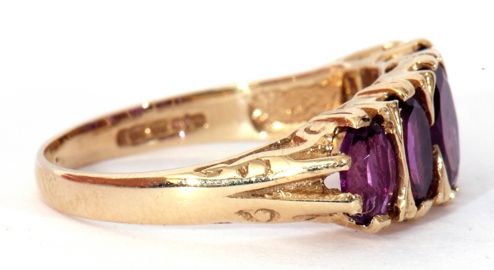 9ct gold amethyst five stone ring, featuring five graduated oval shaped amethysts, all in a carved - Image 8 of 9
